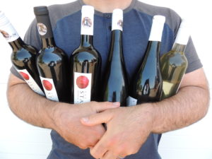 Dad Pack wines in the arms of a dad
